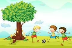 Dzieciaki bawić się futbol Obraz Royalty Free
