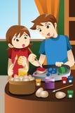 Dzieciaki maluje Wielkanocnych jajka Fotografia Royalty Free