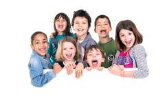 Dzieciaki nad białą deską Obrazy Stock