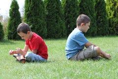 dzieciaki obrażający Fotografia Royalty Free