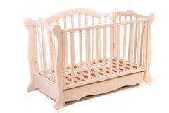Dziecka łóżko drewniany na białym tle Fotografia Stock