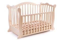 Dziecka łóżko drewniany na białym tle Obrazy Royalty Free