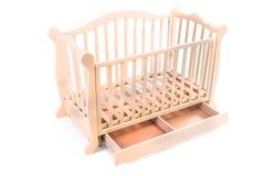 Dziecka łóżko drewniany na białym tle Obraz Stock