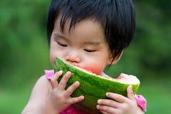 dziecka łasowania arbuz Obraz Royalty Free