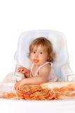 dziecka łasowania dziewczyny upaćkany spaghetti fotografia stock