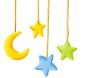 Dziecka ściąga wiesza wiszącej ozdoby zabawkę - księżyc i gwiazdy Obrazy Royalty Free