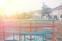 Dziecka carousel w wiosce - rocznik Fotografia Stock