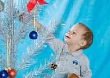 Dziecka i Nowego Roku drzewo Zdjęcia Stock
