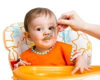 Dziecka karmienie z łyżką Zdjęcia Royalty Free