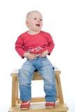 dziecka krzesła obsiadanie Obraz Royalty Free