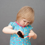 dziecka opadowa dziewczyny dolewania łyżka zdjęcia royalty free