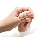 dziecka ręki mienia matka Zdjęcie Stock