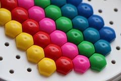 Dziecka ` s mozaika tło barwiąca dziecka ` s mozaika barwioni lampasy plastikowi szczegóły dziecka ` s mozaika Zdjęcie Stock