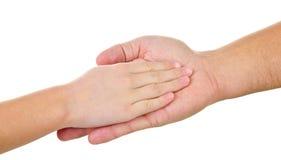 Dziecka ` s ręka w mężczyzna ` s palmie Fotografia Stock