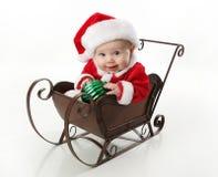 dziecka Santa siedzący sanie Zdjęcia Stock