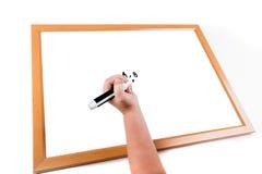 Dziecka writing na suchym wymazuje deskę Fotografia Royalty Free