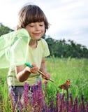 Dziecko łapie motyla Zdjęcie Stock