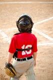 Dziecko bawić się łapacza podczas baseball gry fotografia stock