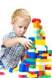 Dziecko bawić się z zabawkami Obraz Royalty Free