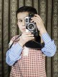Dziecko bierze obrazki z rocznik kamerą Zdjęcie Stock