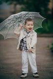 Dziecko chłopiec z koronkowym parasolem Zdjęcia Stock