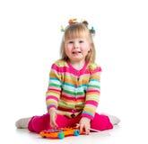 Dziecko dziewczyna bawić się z zabawką Zdjęcia Stock