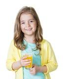 Dziecko dziewczyna trzyma szklanego sok pomarańczowego odizolowywający na bielu Obrazy Stock