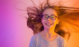 Dziecko dziewczyna z długie włosy lataniem - kolorowy tło Obrazy Royalty Free