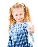 Dziecko dziewczyny mienia otwarta butelka woda Obraz Royalty Free