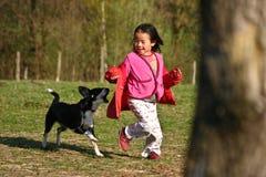 Dziecko i pies obrazy royalty free