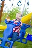 Dziecko jedzie huśtawkę Zdjęcie Stock
