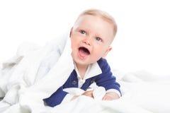 Dziecko jest łgarskim puszkiem na podłoga Zdjęcie Stock