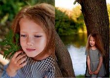 Dziecko jest 4 lat z niebieskimi oczami i małymi kędziorami, Stojaki blisko wielkiego drzewa obok wody Dziecka ` s Fotografia Royalty Free