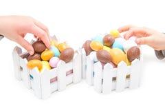 Dziecko kraść Wielkanocnych jajka Fotografia Royalty Free