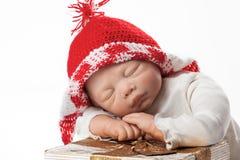 Dziecko - lala z Boże Narodzenie Nakrętką fotografia royalty free