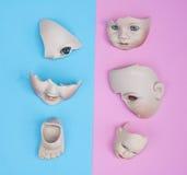 Dziecko lali głowa, ręki, twarzy części na błękicie i menchii tło -, Zdjęcia Royalty Free