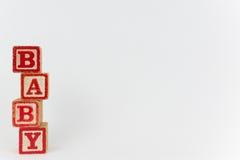 Dziecko Literujący w blokach na Białym tle fotografia stock
