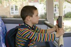 Dziecko na autobusie Zdjęcia Stock