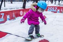 Dziecko na snowboard Obraz Royalty Free