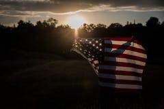Dziecko pokazuje patriotyzm dla jego swój kraju, Jednoczy stany Fotografia Stock
