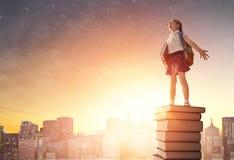 Dziecko pozycja na książkach Fotografia Stock