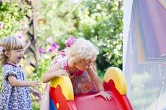 Dziecko przejażdżka od wzgórza Fotografia Stock