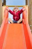 Dziecko przygotowywający iść puszek w pomarańczowym obruszeniu Zdjęcia Stock