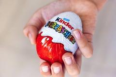 Dziecko ręka z Miłym niespodzianki jajkiem Obrazy Royalty Free