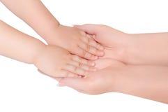 dziecko ręki trzymają małej kobiety Zdjęcie Stock