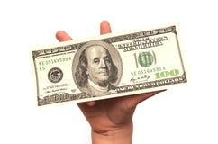 Dziecko ręka trzyma 100 dolarów Obrazy Stock