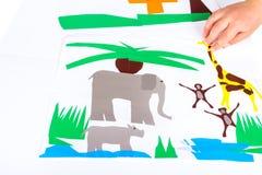 Dziecko robi wycinankom Obrazy Royalty Free