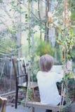 Dziecko siedzi na huśtawce Fotografia Royalty Free