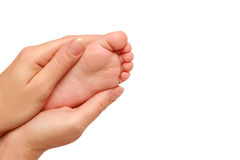 Dziecko stopa w żeńskich rękach Obrazy Stock