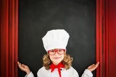 Dziecko szefa kuchni kucharz Restauracyjnego biznesu pojęcie Zdjęcia Royalty Free